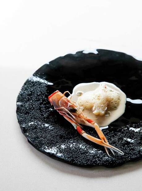 Scampi with hazelnut butter foam and orange confit from MAD