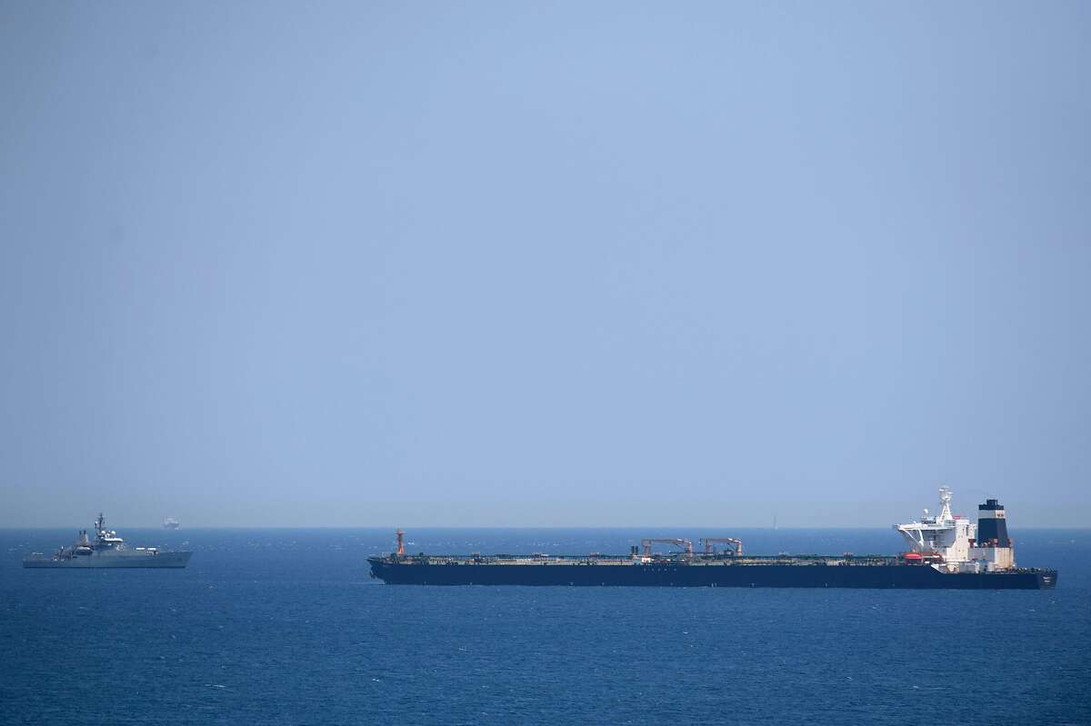 A British Royal Navy ship (L) patrols near supertanker Grace 1 suspected of carrying crude oil to Syria in violation of EU sanctions after it was detained off the coast of Gibraltar on July 4, 2019. - Authorities did not say where the oil came from but specialised shipping trade publication Lloyd's List said the Panamanian-flagged tanker was thought to be transporting crude from Iran. (Photo by JORGE GUERRERO / AFP)JORGE GUERRERO/AFP/Getty Images