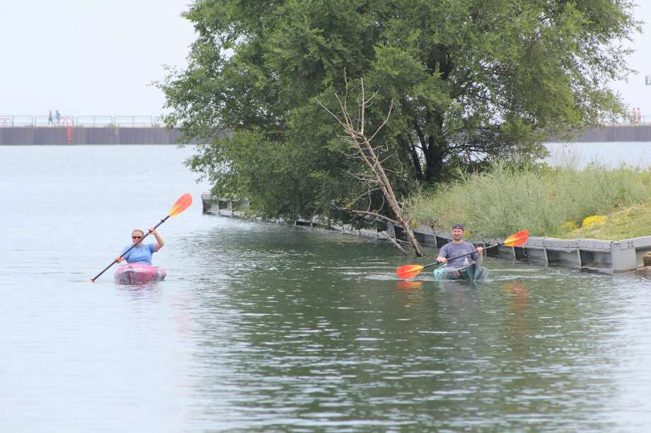 Residents and out-of-towners enjoy the weather at Port Austin during the Fourth of July weekend. People lay at the beach, kayaked, took boat rides, and walked along the Port Austin Break Wall. Photo: Robert Creenan/Huron Daily Tribune