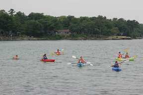 Residents and out-of-towners enjoy the weather at Port Austin during the Fourth of July weekend. People lay at the beach, kayaked, took boat rides, and walked along the Port Austin Break Wall.