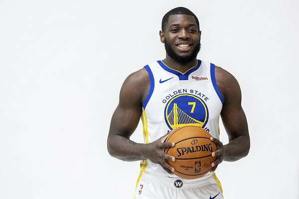 Golden State Warriors NBA basketball draft pick Eric Paschall stands for team photos on Monday, June 24, 2019, in Oakland, Calif. (AP Photo/Noah Berger)