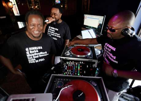 """Jason """"DJ Burb"""" Rogers, left, Marcus """"MistaGoodBar"""" Black, center, and Greg """"DJ NIMBUS"""" Stevens, right, perform at their Paid in Full event at Faces Ultra Lounge, 5104 Almeda Rd., Saturday, June 8, 2019, in Houston."""