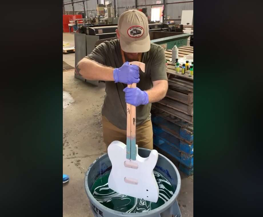 "A workshop hosted by the STEM Guitar Institute last week in Houston showed participants the mesmerizing process of creating a guitar from scratch, including dyeing the instrument through a process called ""hydro dipping."" Photo: Courtesy Of TX/RX Labs"