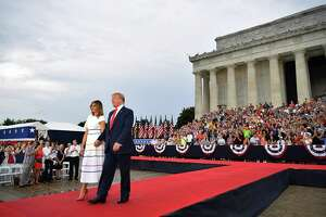 "US President Donald Trump and First Lady Melania Trump arrive to ""Salute to America"" Fourth of July event at the Lincoln Memorial in Washington, DC, July 4, 2019. (Photo by MANDEL NGAN / AFP)MANDEL NGAN/AFP/Getty Images"