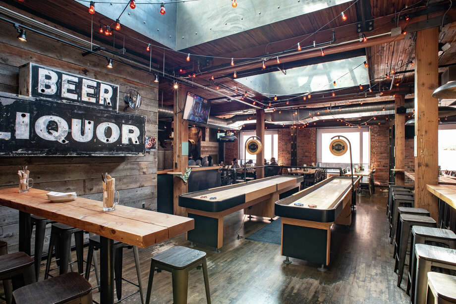Brave Horse Tavern: Its a South Lake Union Tom Douglas tavern, which means your pub grub is going gourmet -- hot pepper chicken wing style. Alongside dozens of craft brews, pal around post-work with plenty of shuffleboard shenanigans. Photo: Todd Rotkis