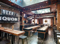 Brave Horse Tavern  : Its a South Lake Union Tom Douglas tavern, which means your pub grub is going gourmet -- hot pepper chicken wing style. Alongside dozens of craft brews, pal around post-work with plenty of shuffleboard shenanigans.