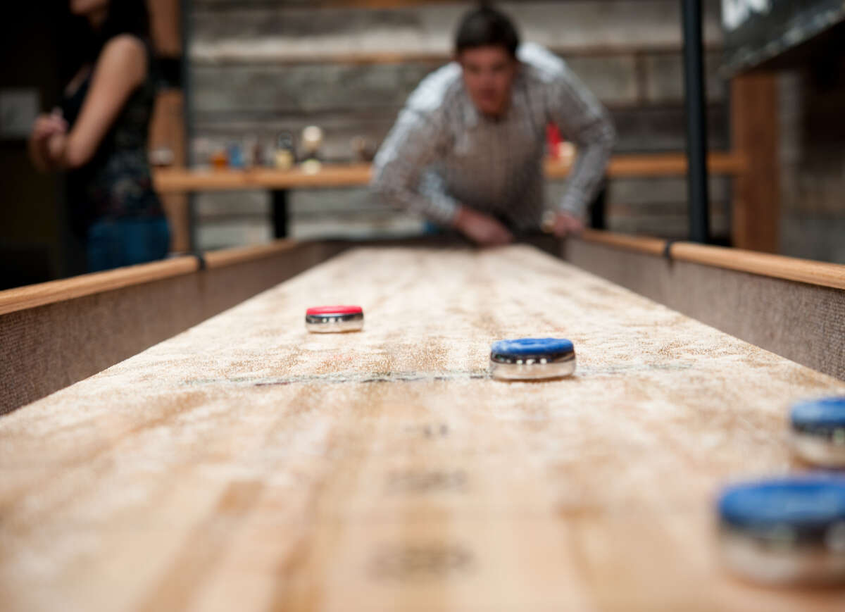 Let the shuffleboard shenanigans commence. Here, Brave Horse Tavern slides out pucks like it does gourmet pub grub. Keep clicking for more spots around Seattle for both drinks and play.