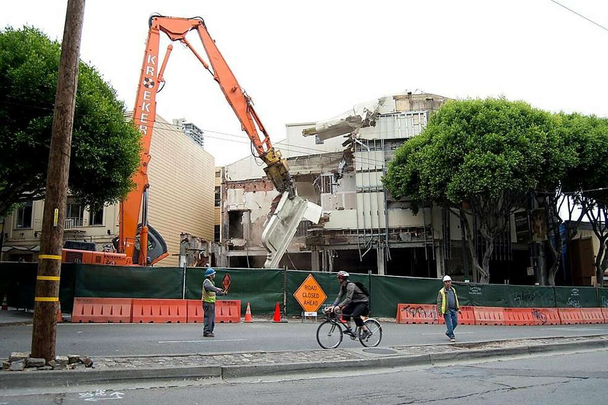 The Pagoda Palace Theater, which has been an abandoned building in North Beach for 20 years, is demolished on August 20. Early Tuesday morning workers using a machine nicknamed