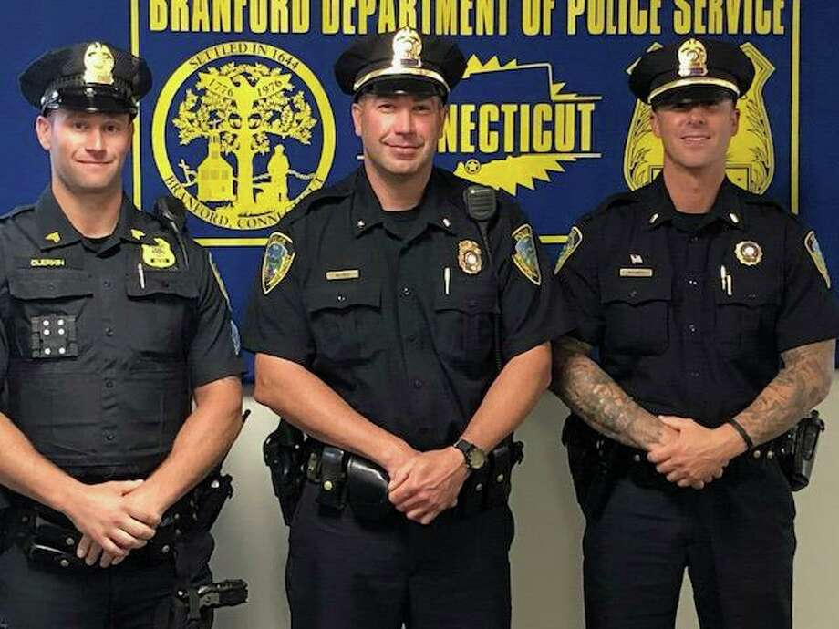 Newly-promoted Branford Police Department Deputy Chief John Alves, center, is flanked in this recent photo by Sgt. Matthew Clerkin, left, who now will serve as a patrol shift supervisor, and newly-promoted Lt. Phillip Ramey, right, who will now serve as a patrol shift commander. Photo: Branford Police Department