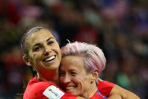 Alex Morgan of the USA celebrates with teammate Megan Rapinoe after scoring her team's twelfth goal during the 2019 FIFA Women's World Cup France group F match between USA and Thailand at Stade Auguste Delaune on June 11, 2019 in Reims, France. (Robert Cianflone/Getty Images/TNS)