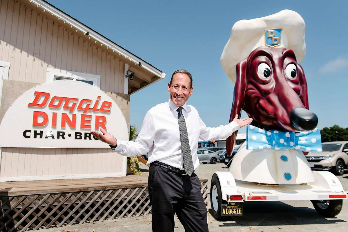 Kip Atchley poses for a portrait with his Doggie Diner head in Napa, Calif., on July 5th, 2019. Napa resident Kip Atchley wants to resurrect Doggie Diner, the fast-food chain that maintained locations in San Francisco and Oakland from the 1940s to the 1980s