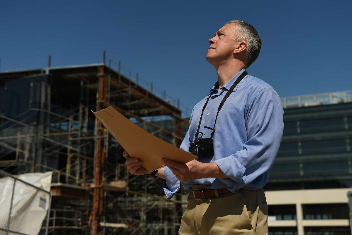 Appraiser Matthew D. Boxberger of Santa Clara County visits a construction site in San Jose.
