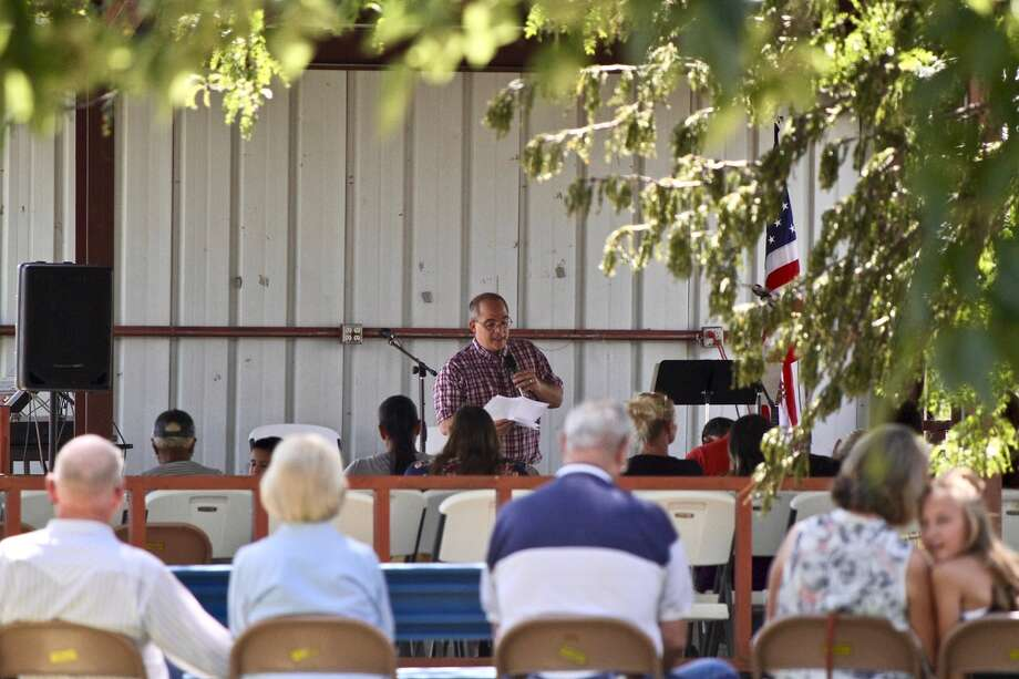 Hale Center community members raise $1,868 for Mission Hale Center during a weekend church service. Photo: Don Brown/For The Herald