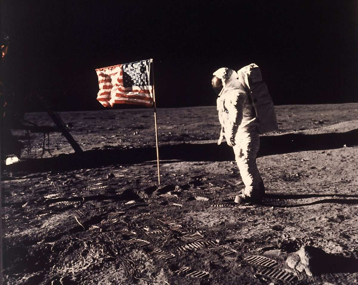 FILE - In this image provided by NASA, astronaut Buzz Aldrin poses for a photograph beside the U.S. flag deployed on the moon during the Apollo 11 mission on July 20, 1969. Television is marking the 50th anniversary of the July 20, 1969, moon landing with a variety of specials about NASA's Apollo 11 mission. (Neil A. Armstrong/NASA via AP, File)