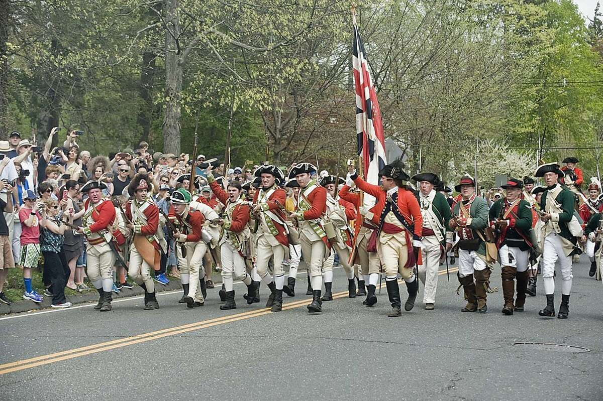 British soldiers charge the Continental Army in the 240th anniversary of the Battle of Ridgefield. Saturday, April 29, 2017