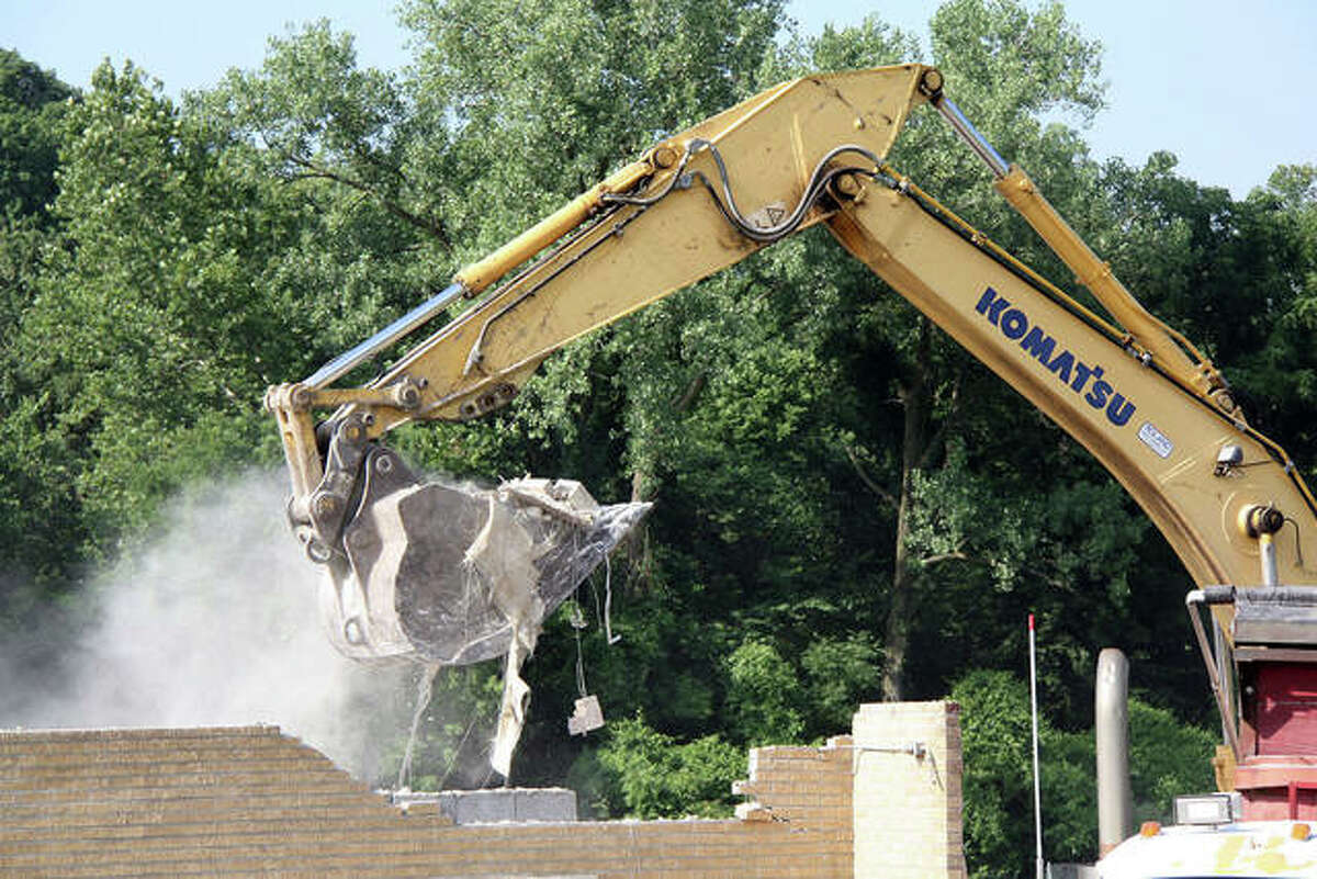 A backhoe takes a bite out of the brick that was once the Glen Carbon Fire Department. Ground was broken for the new station, 199 S. Main St., last August.