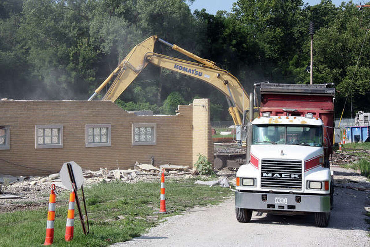 The backhoe was in the midst of ripping apart the former chief's office, living space and kitchen of the former Glen Carbon Fire Protection District station on Main Street Friday.