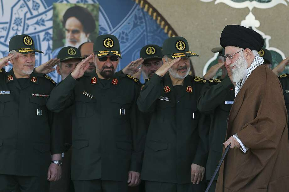 FILE- In this picture released by an official website of the office of the Iranian supreme leader, former commander of the Revolutionary Guard Mohsen Rezaei, second left, salutes Supreme Leader Ayatollah Ali Khamenei, right, while he arrives at a graduation ceremony of the Revolutionary Guard's officers, in Tehran, Iran.  Former leader of Iran's powerful Revolutionary Guard Mohsen Rezaei said on Friday, July 5, 2019, that the Islamic Republic should consider seizing a British oil tanker in response to authorities detaining an Iranian oil tanker off the coast Gibraltar. (Office of the Iranian Supreme Leader via AP, FILE) Photo: Uncredited, Associated Press