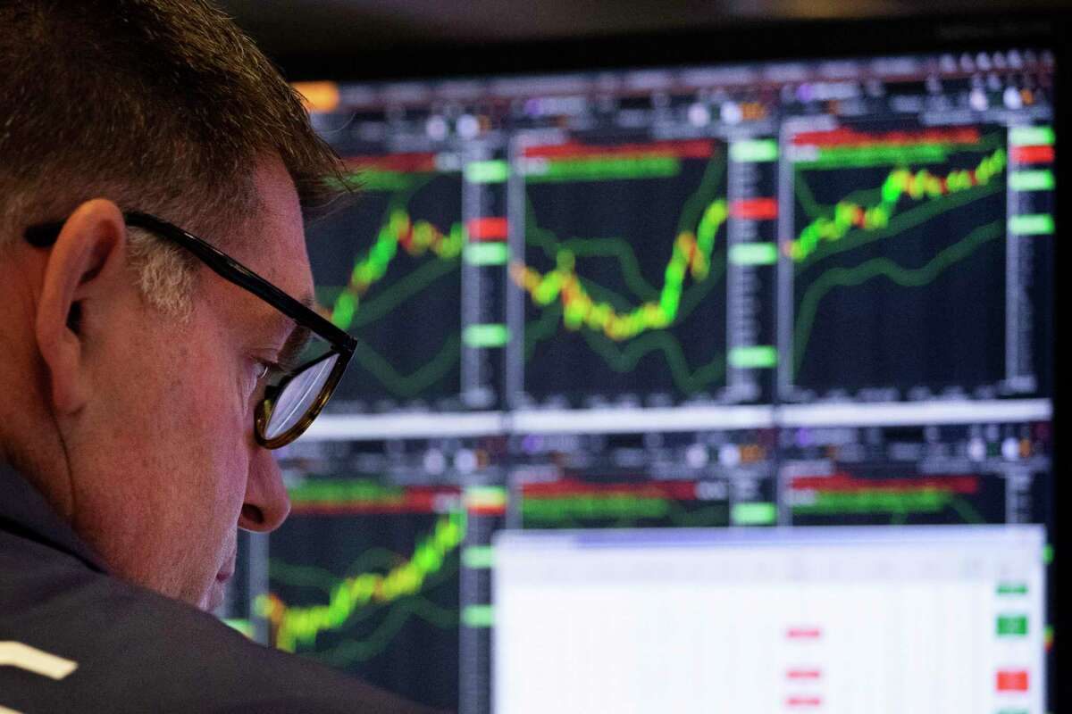 A trader works at the New York Stock Exchange, Friday, July 5, 2019 in New York. (AP Photo/Mark Lennihan)