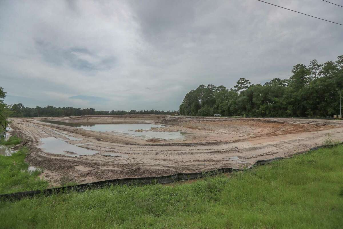 A Cypress Creek resident raised concerns about a new development, an apartment building for seniors, on the north bank of the creek at Cutten Road Wednesday, July 3, 2019, in Houston.