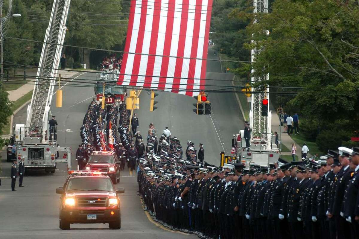 Funeral services for Bridgeport Fire Department Firefighter Michel Baik, in Bridgeport, Conn. Friday July 30th, 2010.