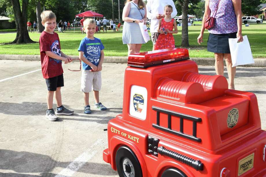 Kyle Moshier (6) and his brother Tyler (5) interact with Freedie the Fire Truck during the Katy Freedom Celebration on Thursday, July 4, at Katy Fire Station #1. Photo: Craig Moseley, Houston Chronicle / Staff Photographer / ©2019 Houston Chronicle