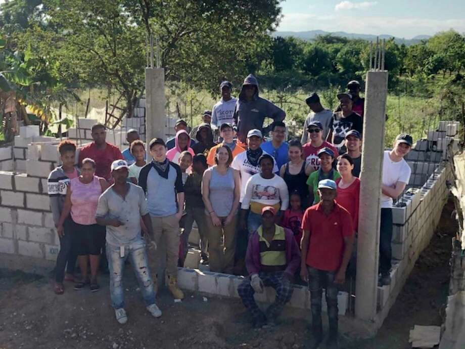 Brookfield-based nonprofit Cambiando Vidas, started in May 2007, celebrates 100th house built in Dominican Republic. Team photo first day of the build Photo: Contributed Photo / The News-Times / The News-Times Contributed