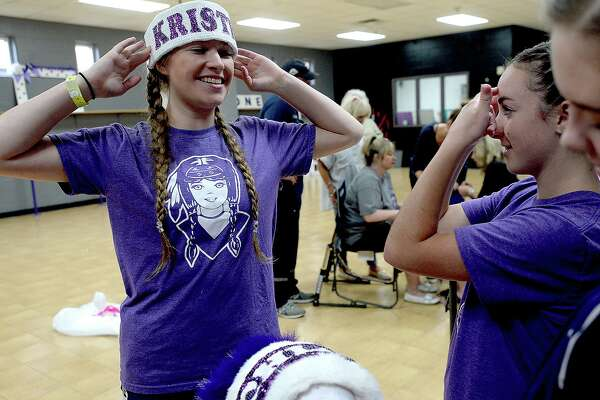Indianettes captain Kristen Crippen jokes with Channing Hebert as the Indianettes gather during a headdress building workday at Port Neches - Groves High School Monday. Photo taken Monday, June 24, 2019 Kim Brent/The Enterprise