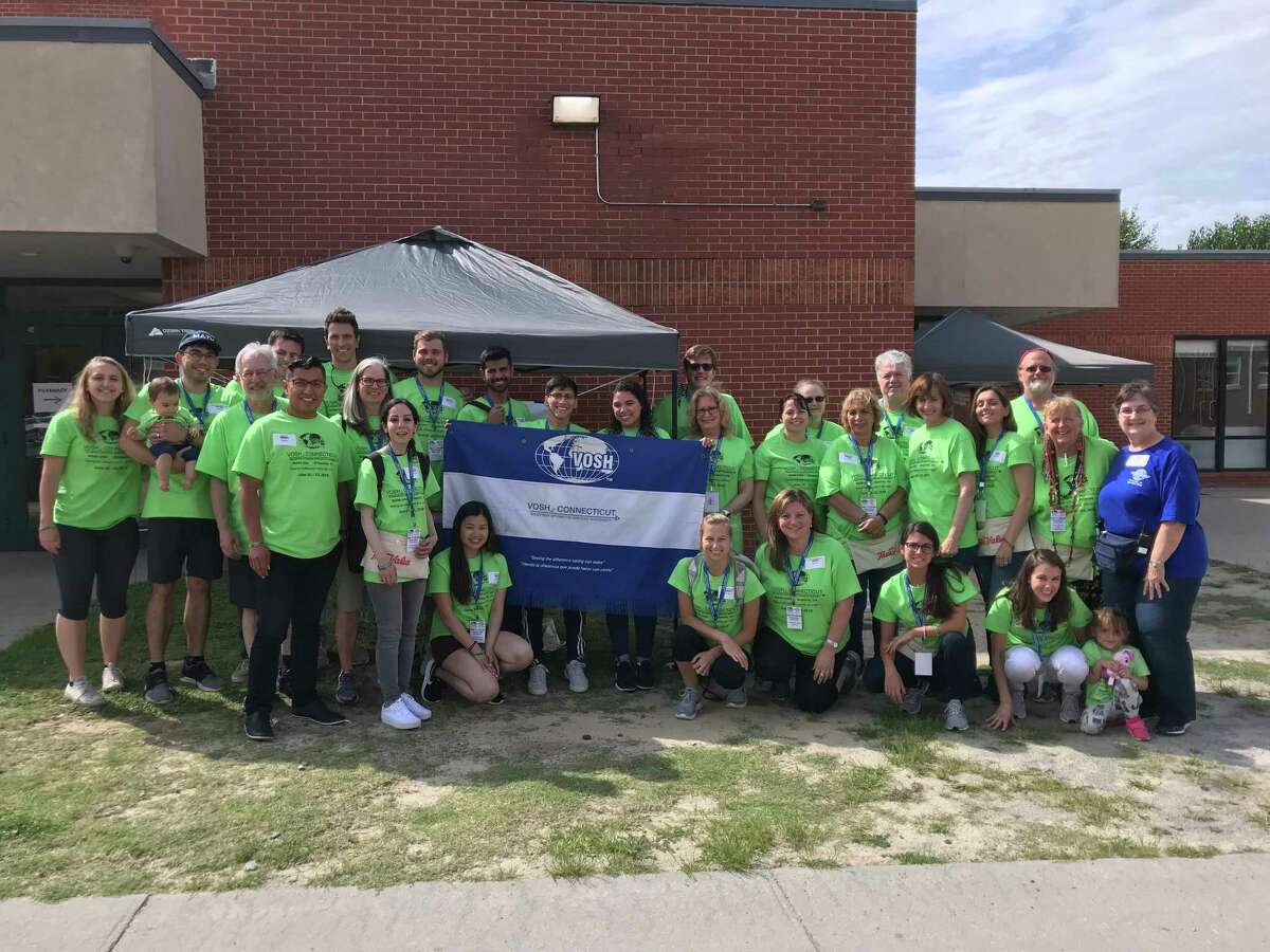 Members of VOSH Connecticut, a group of optometrists who provide free vision and eye care services to people in need, traveled to Virginia earlier this summer for a two-day eye care clinic.