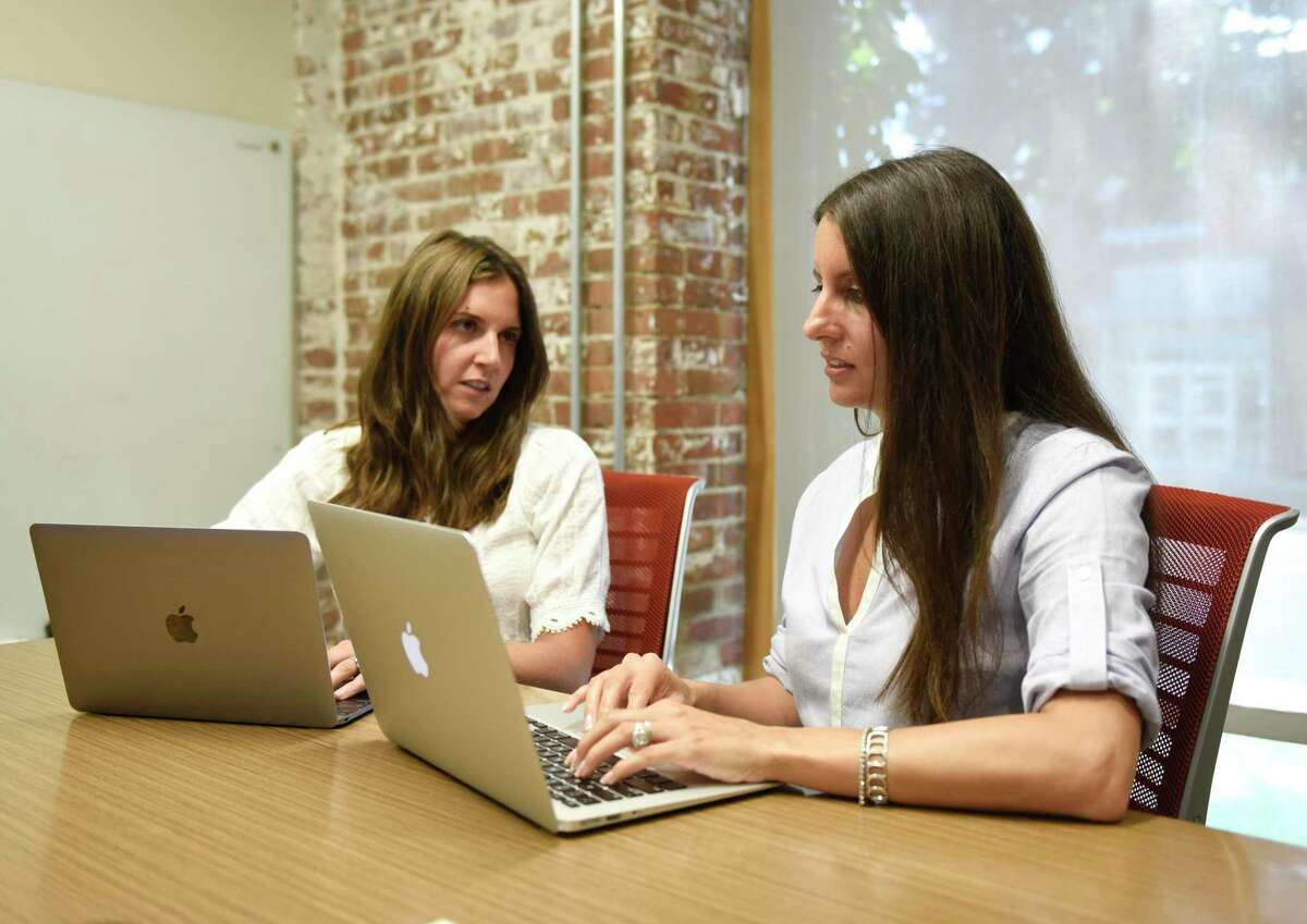 Local Moms Network co-founders Megan Sullivan, left, and Layla Lisiewski pose at the Serendipity Labs co-working space in Stamford, Conn. Monday, July 1, 2019. The Local Moms Network, which includes the website Greenwich Moms, has rapidly expanded since it was founded in 2015 and will have more than 100 towns in the network by the end of 2019.