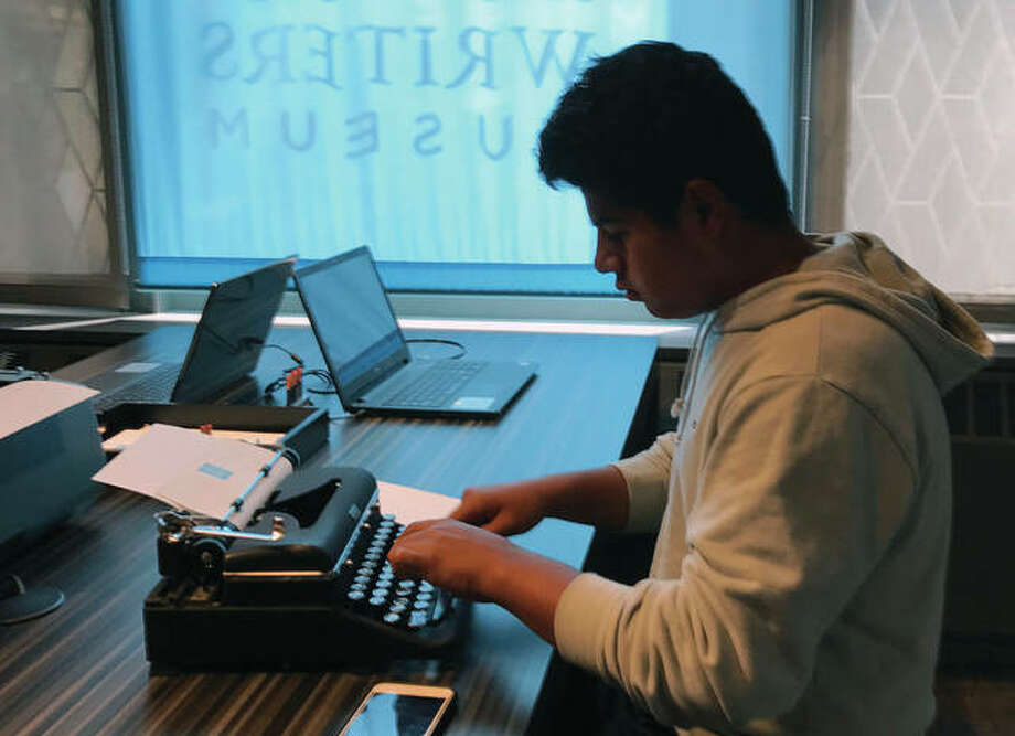 """A teenage visitor uses a typewriter on display at the American Writers Museum in Chicago. A younger generation is discovering the joy of the feel and sound of the typewriter. Two recent documentaries, """"The Typewriter (In The 21st Century)"""" (2012) and """"California Typewriter"""" (2016), featuring collector Tom Hanks, have helped popularize vintage typewriters among young people, who also have a soft spot for other analog technologies like vinyl records and fountain pens. Photo: Julia Rubin   AP"""