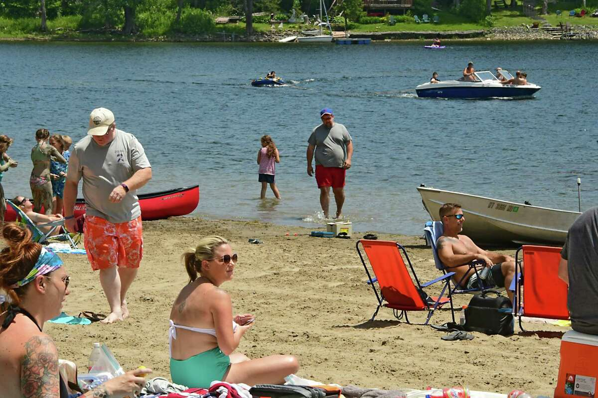 The beach was bustling with people trying to keep cool on a hot day at Thompson's Lake Campground on Friday, July 5, 2019, East Berne, N.Y. (Lori Van Buren/Times Union)