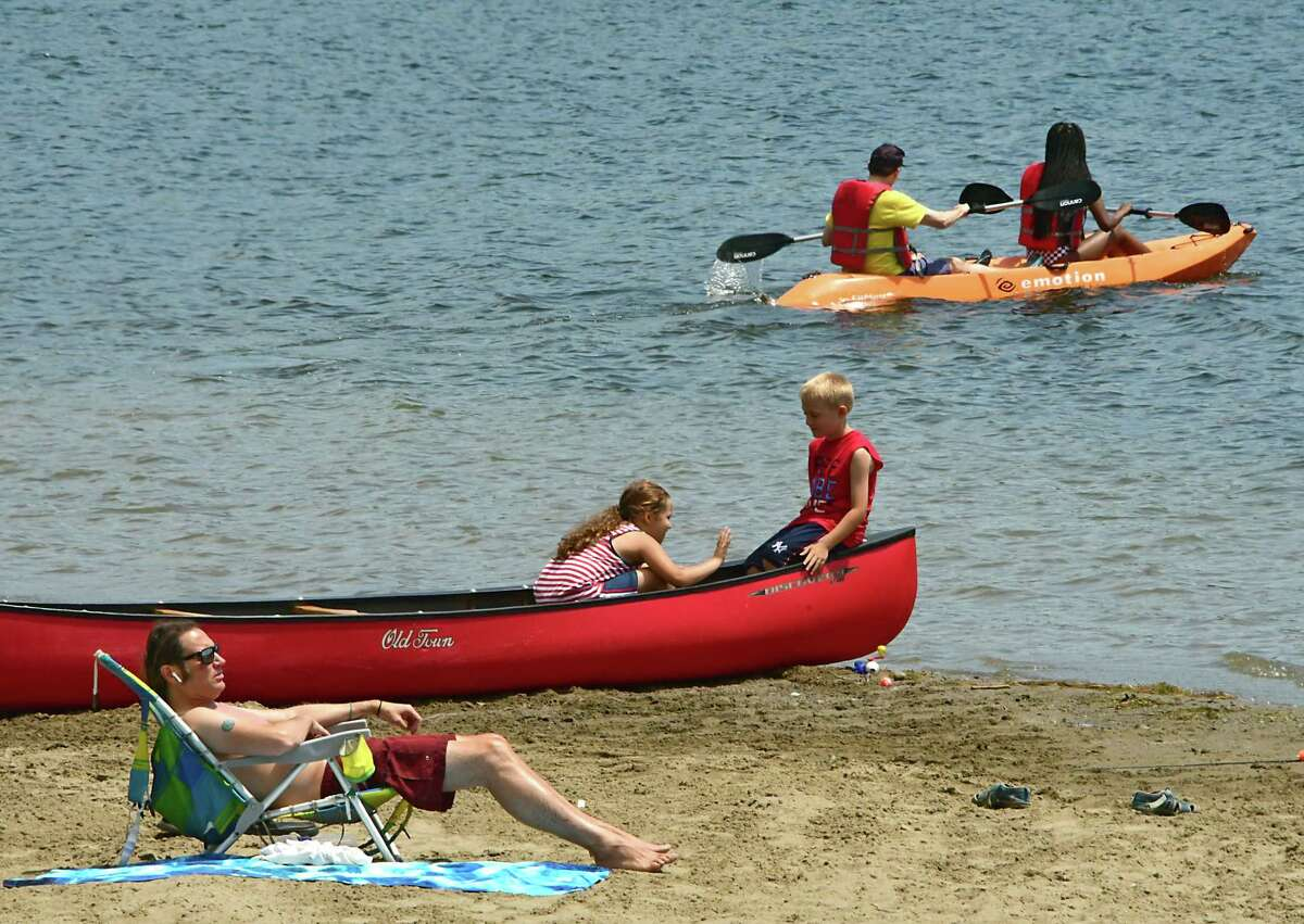 People sunbath and boat at the beach at Thompson's Lake Campground on Friday, July 5, 2019, East Berne, N.Y. (Lori Van Buren/Times Union)