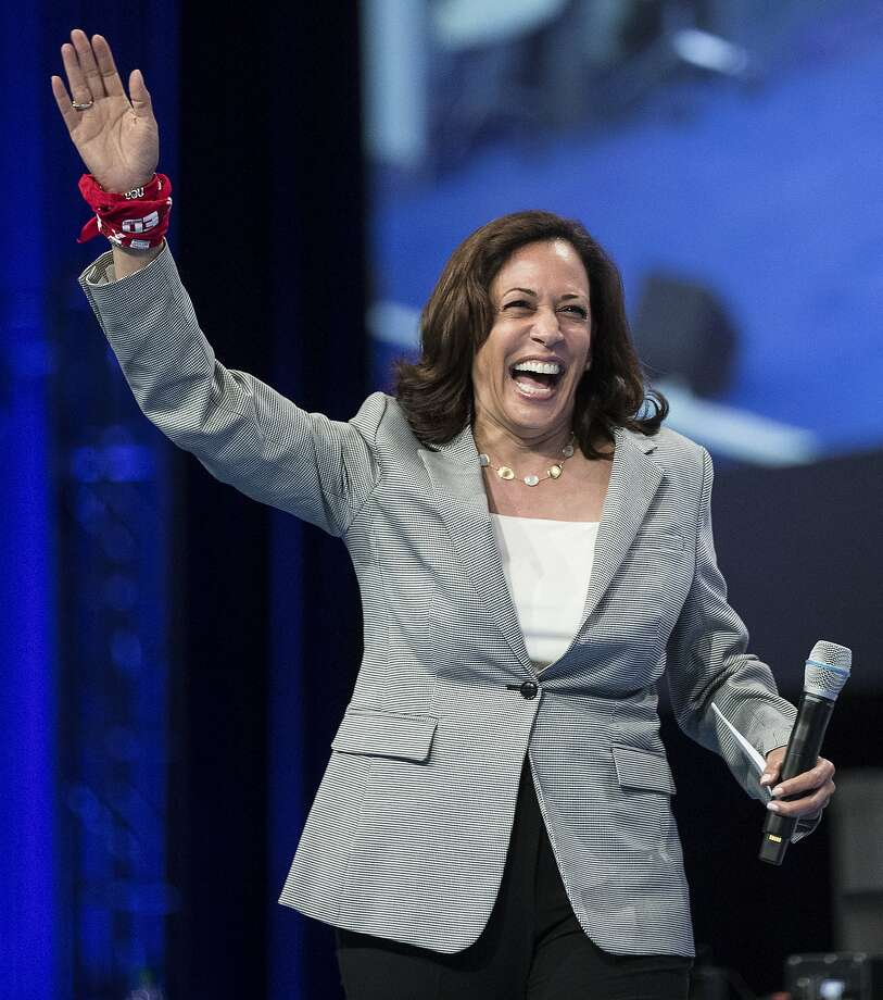 Democratic presidential hopeful, California Sen. Kamala Harris, waves as she arrives on stage to speak during the National Education Association Strong Public Schools Presidential Forum on Friday, July 5, 2019, in Houston. Photo: Brett Coomer, Staff Photographer