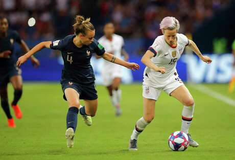 France's Marion Torrent, left, challenges United States' Megan Rapinoe during the Women's World Cup quarterfinal soccer match between France and the United States at the Parc des Princes, in Paris, Friday, June 28, 2019.