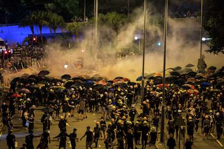 Police fire tear gas as they charge toward protesters outside the Legislative Council Complex on Tuesday, July 2, 2019, in Hong Kong, China. (Billy H.C. Kwok/Getty Images/TNS) **FOR USE WITH THIS STORY ONLY**