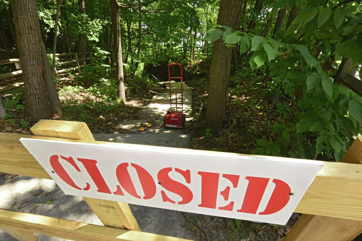 A closed sign is seen at the entrance to the Indian Ladder Trail at John Boyd Thacher State Park on Friday, July 5, 2019 in New Scotland, N.Y. (Lori Van Buren/Times Union)