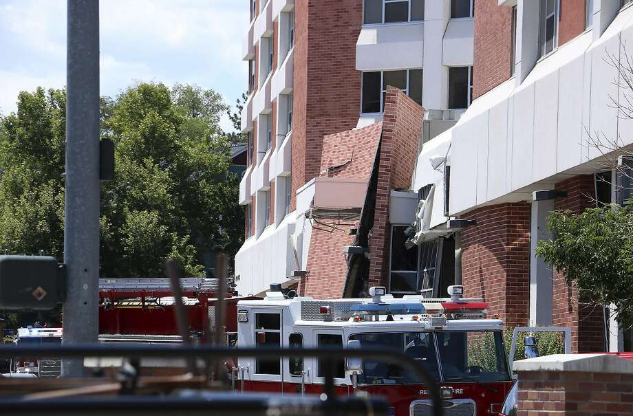Rescue personnel respond to an explosion that damaged Argenta Hall and Nye Hall on the University of Nevada, Reno campus on Friday, July 5, 2019, in Reno, Nev. A utilities explosion Friday at the University of Nevada, Reno caused the partial collapse of a dormitory building and at least minor injuries, authorities said. (Jason Bean/The Reno Gazette-Journal via AP) Photo: Jason Bean / Associated Press