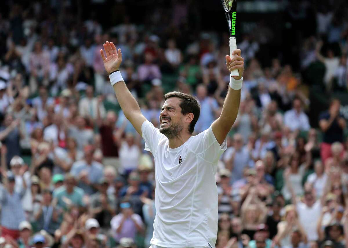 Argentina's Guido Pella celebrates after beating South Africa's Kevin Anderson in a Men's singles match during day five of the Wimbledon Tennis Championships in London, Friday, July 5, 2019. (AP Photo/Ben Curtis)