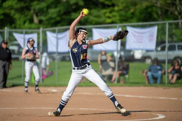 Milford's Maddy bull delivers a pitch during the District IV championship game, Friday, July 5, 2019, at Foote Field in Milford, CT