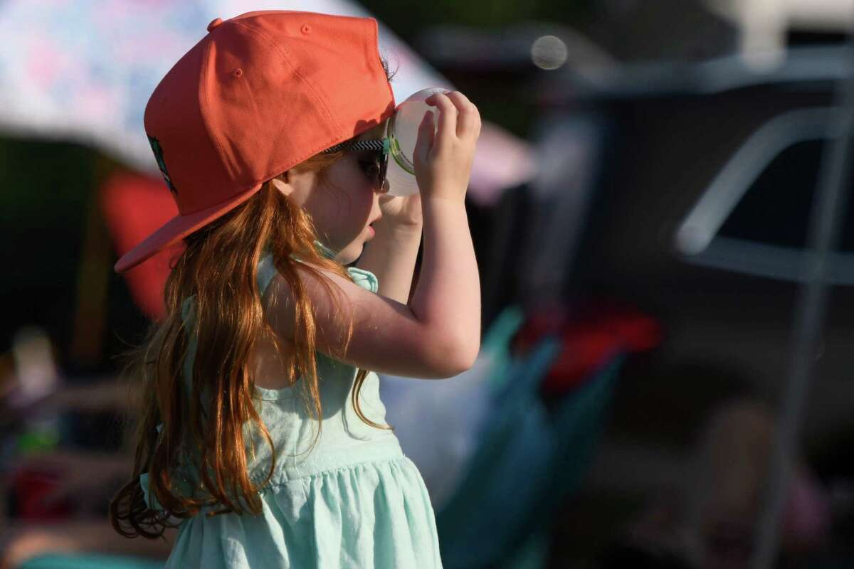 Indiana Davis, 4, cools off by resting a water bottle against her forehead during the season opening match at Saratoga Polo Club between RoseView Farms and Saratoga on Friday, Jul. 5, 2019 in Greenfield, N.Y. Temperatures reached the 90s in Saratoga County today. (Jenn March, Special to the Times Union)