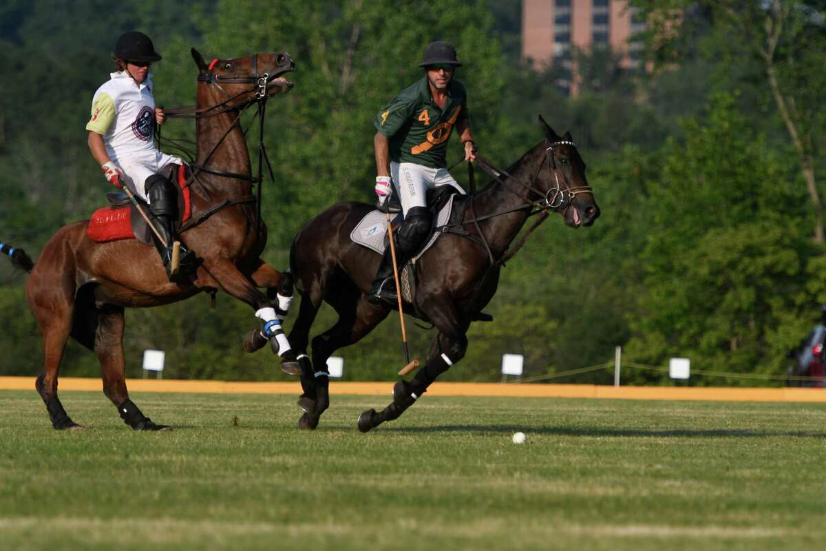 Pablo Donignac for RoseView Farms and Saratoga's Mario Dino pursue the ball on their mounts during the season opening match at Saratoga Polo Club on Friday, Jul. 5, 2019 in Greenfield, N.Y. (Jenn March, Special to the Times Union )