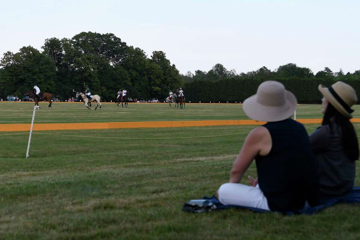 Spectators engage in conversation as they watch the season opening match at Saratoga Polo Club between RoseView Farms and Saratoga on Friday, Jul. 5, 2019 in Greenfield, N.Y. (Jenn March, Special to the Times Union )