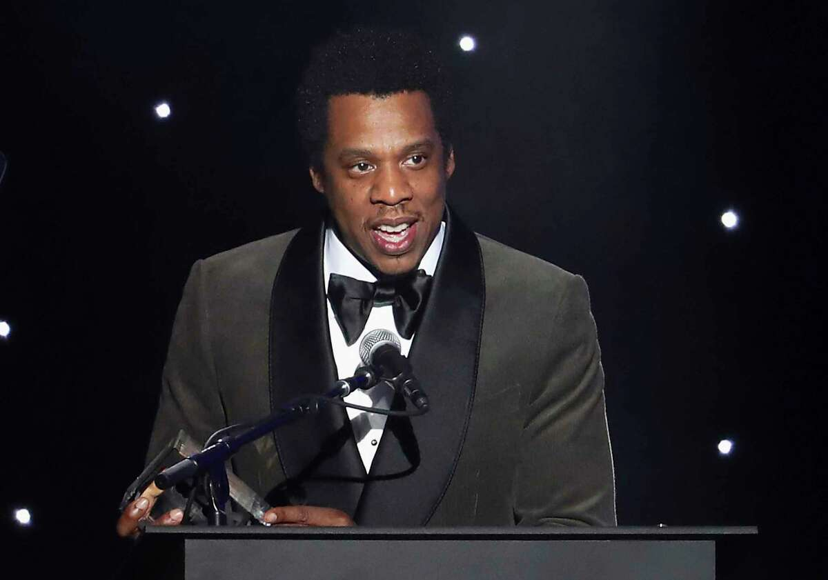 FILE - In this Jan. 27, 2018, file photo, honoree Jay-Z speaks onstage at the 2018 Pre-Grammy Gala And Salute To Industry Icons at the Sheraton New York Times Square Hotel in New York. Jay-Z?s business entities have sued a New York City licensing firm, claiming it cheated the companies as part of a ?colossal accounting scandal.? The lawsuit, filed on Thursday, July 4, 2019, in Manhattan, accuses Iconix Brand Group Inc. of lying about its finances when it made deals with the rapper?s Roc Nation apparel company. (Photo by Michael Zorn/Invision/AP, File)