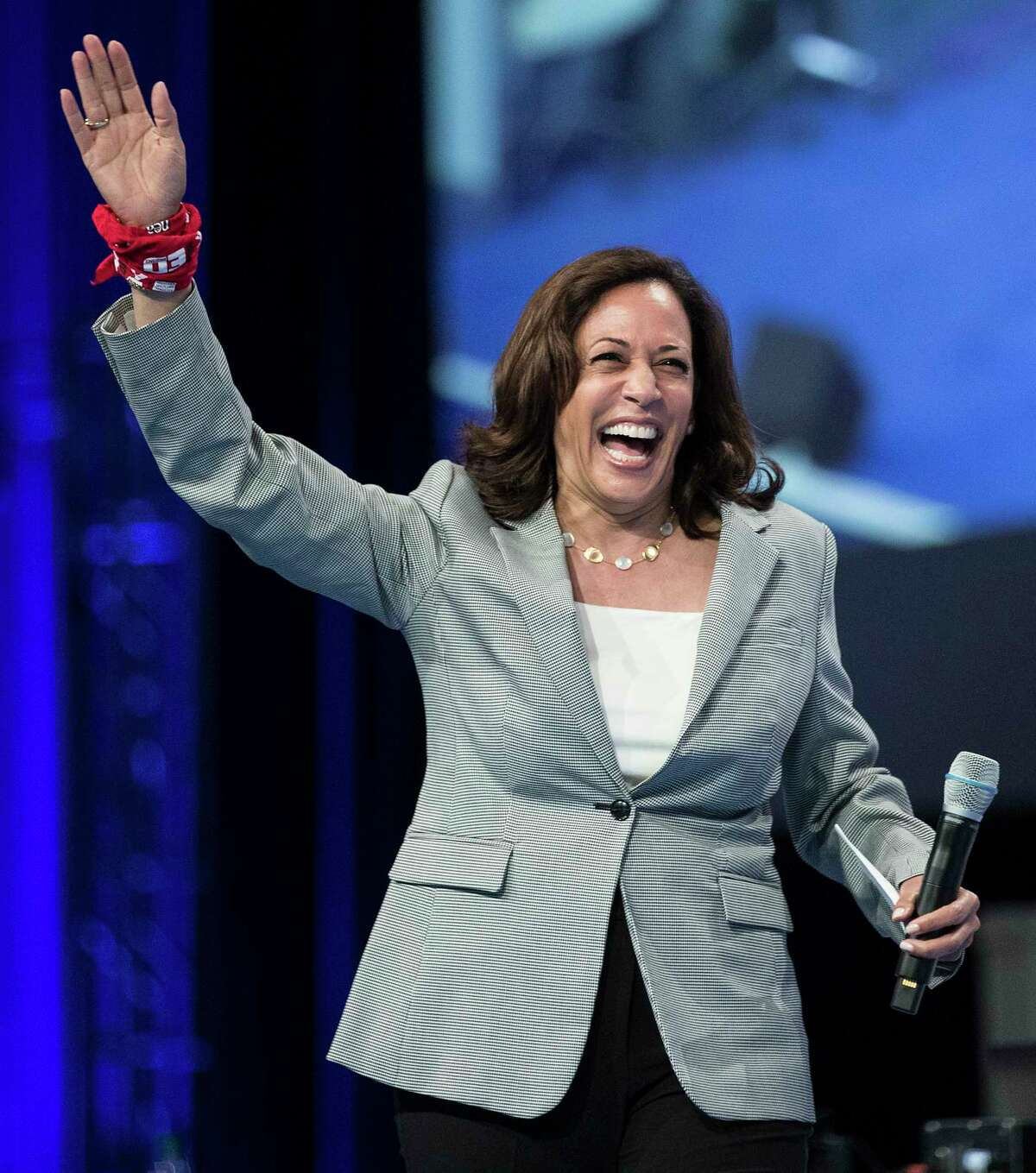 Democratic presidential hopeful, California Sen. Kamala Harris, waves as she arrives on stage to speak during the National Education Association Strong Public Schools Presidential Forum on Friday, July 5, 2019, in Houston.