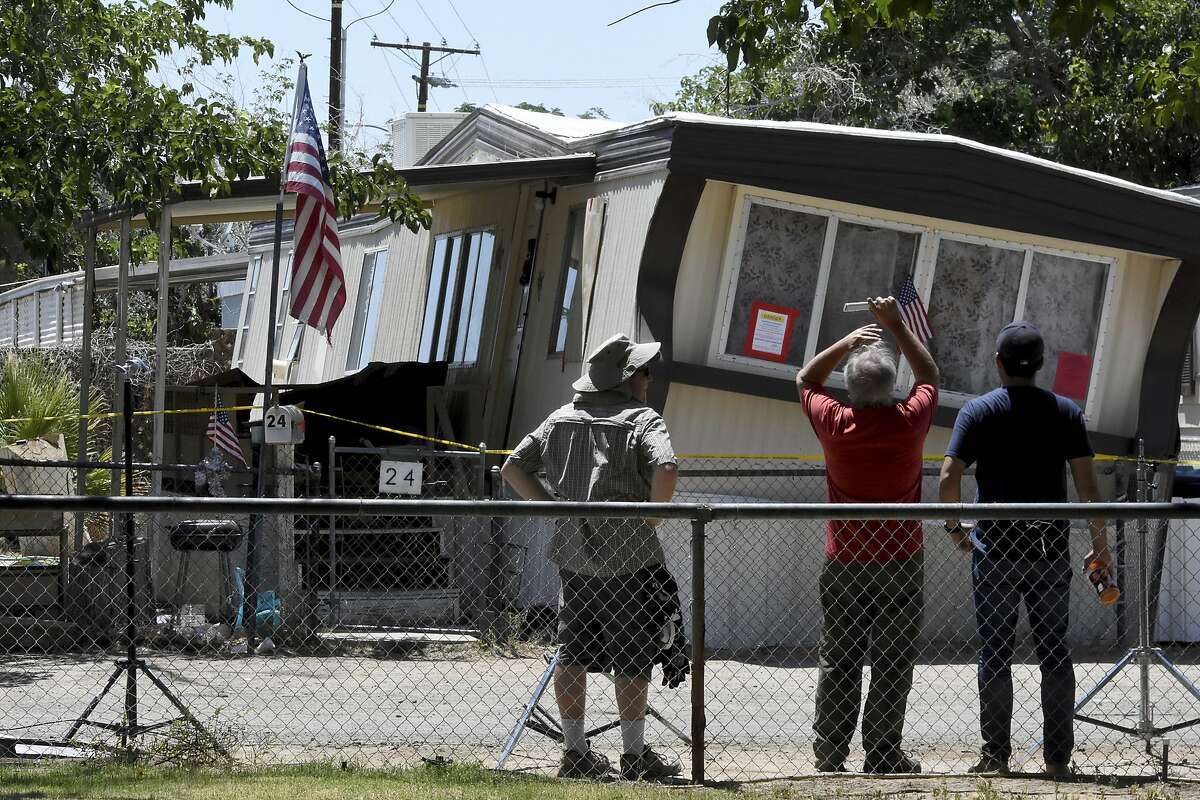 People observe a mobile home in Ridgecrest, Calif. on Friday July 5, 2019.