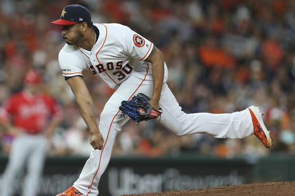 Houston Astros relief pitcher Hector Rondon (30) pitches during the top eighth inning of the MLB game against the Los Angeles Angels at Minute Maid Park on Friday, July 5, 2019, in Houston.