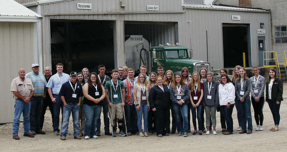 Those taking part in the Livestock Leadership Institute join key leaders from Hueber Feed in front of the feed mill in Creston on the first day of the trip. Photo: Photo Provided