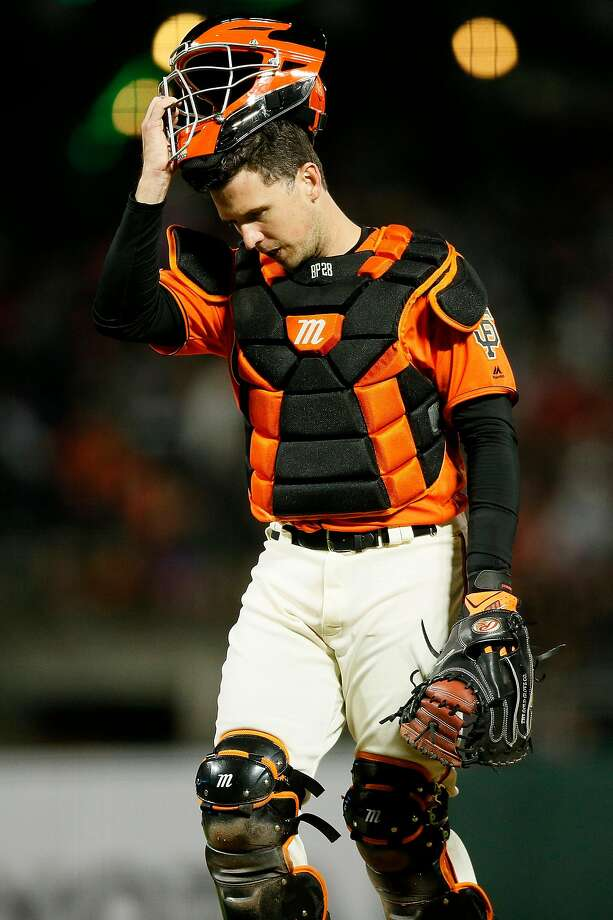 San Francisco Giants catcher Buster Posey (28) walks back to home plate after a mound visit in the 5th inning of an MLB game against the St. Louis Cardinals at Oracle Park on Friday, July 5, 2019, in San Francisco, Calif. Photo: Santiago Mejia / The Chronicle