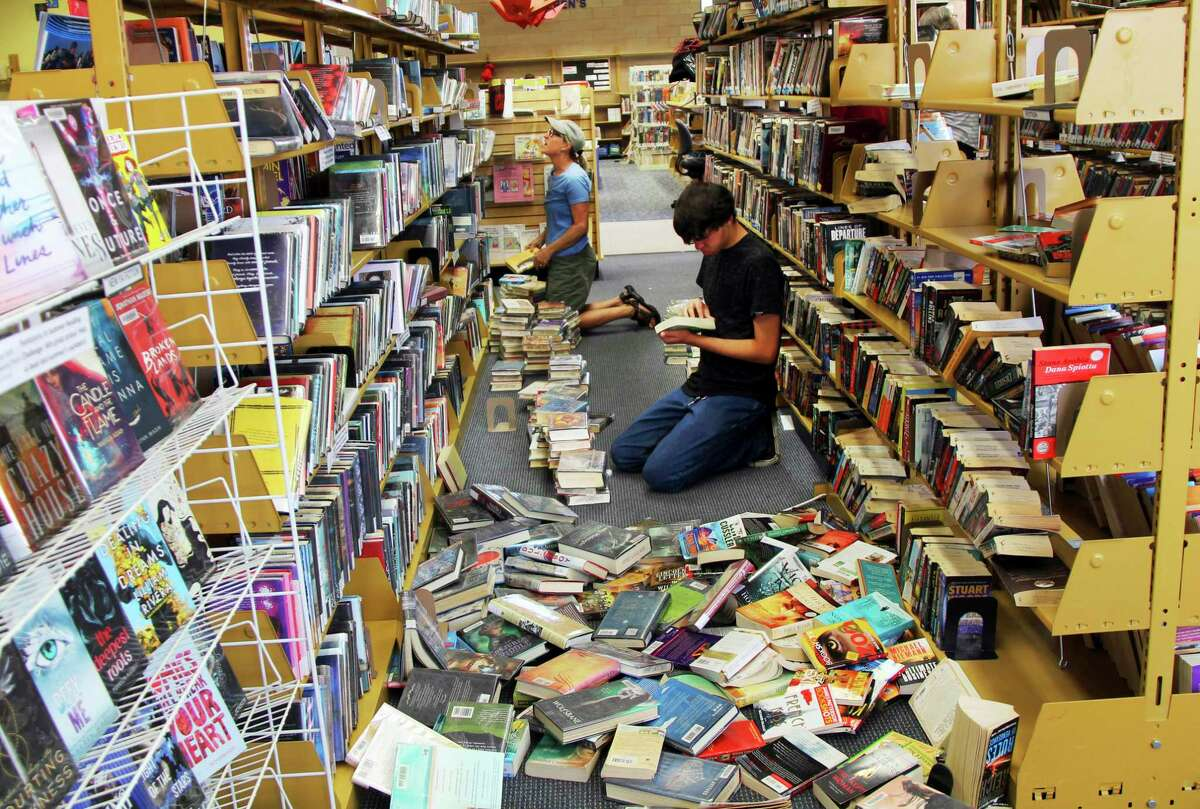 Volunteers assist with cleanup at the Ridgecrest, Calif., branch of the Kern County Library on Friday, July 5, 2019, following a 6.4 magnitude earthquake that shook the region about 150 miles (240 kilometers) northeast of Los Angeles Thursday. Aftershocks from Southern California's largest earthquake in 20 years rumbled beneath the Mojave Desert on Friday as authorities tallied damage in the sparsely populated region. (Jessica Weston/The Daily Independent via AP)